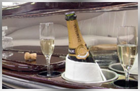 champagne and stocked bar with your party bus or limo